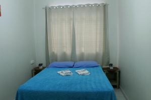 A bed or beds in a room at Hotel Guarany