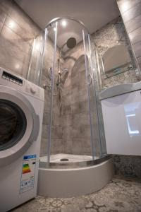 A bathroom at JDK Apartamenty Kalisz Serbinowska