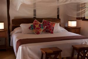 Cama o camas de una habitación en Chaktunche Rancho Ecolodge