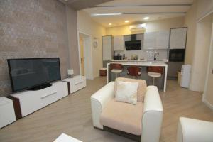 Uma área de estar em UZEIR GADGIBEKOVA 25 Street BULVAR
