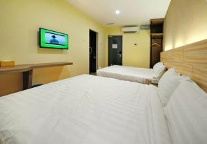 A bed or beds in a room at U Design Hotel Bukit Mertajam