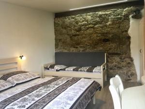 Postel nebo postele na pokoji v ubytování Ubytování u Vydřího mostu