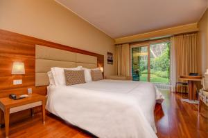 A bed or beds in a room at Hotel Corte Valier