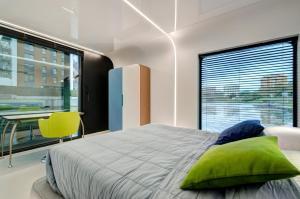Łóżko lub łóżka w pokoju w obiekcie Dom na Wodzie - Flohotel