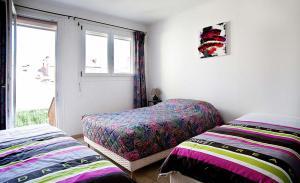 A bed or beds in a room at ApartHotel François 1er 14eme