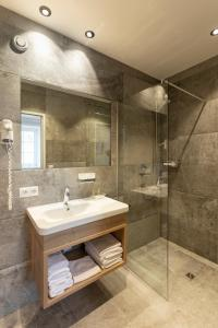 Ein Badezimmer in der Unterkunft Isserwirt