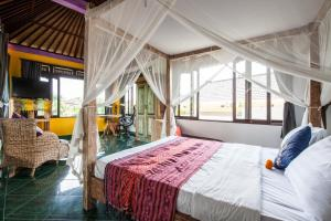 A bed or beds in a room at Villa Cinta