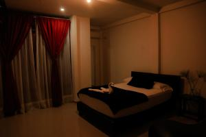 A bed or beds in a room at Hotel Tapyrus
