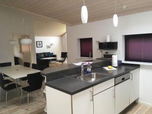 Kuchyň nebo kuchyňský kout v ubytování Ferienhaus Ostseeperle