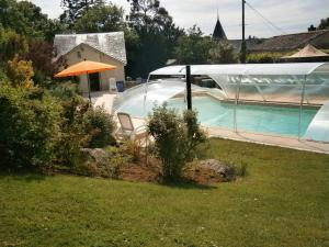 The swimming pool at or near Gite La Petite Folie