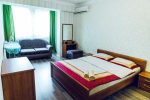 Cama ou camas em um quarto em Apartment with F1 and Caspian Sea view
