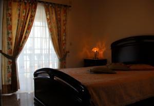 A bed or beds in a room at Casa da Moita