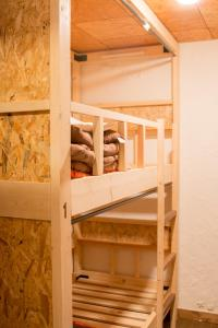 A bunk bed or bunk beds in a room at Guesthouse Kakehashi