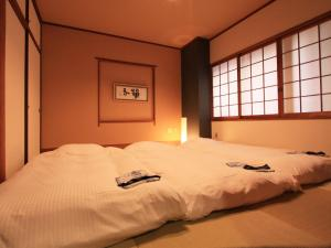 A bed or beds in a room at Hotel AreaOne Takamatsu