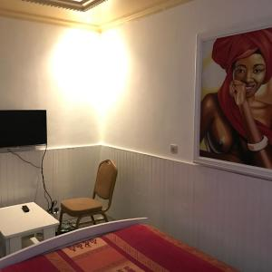 A television and/or entertainment center at Scaimba hotel