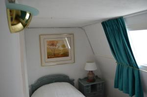 A bed or beds in a room at Fruit of the City - R.Q.C.