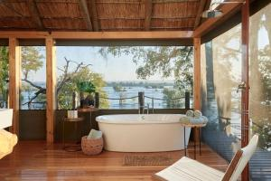 A bathroom at Victoria Falls River Lodge
