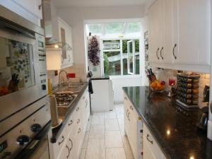 A kitchen or kitchenette at The Crescent Homestay