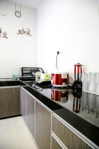 A kitchen or kitchenette at Sibu Swanhouse No.3