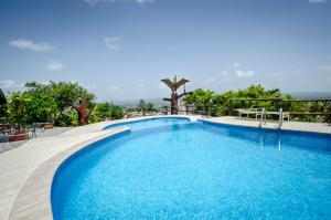 The swimming pool at or near Cahal Pech Village Resort