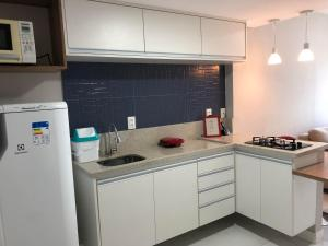 A kitchen or kitchenette at Ondina Apart Hotel
