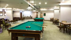 A pool table at Bonaparte Hotel