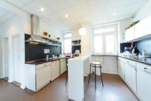A kitchen or kitchenette at Hostel Blues