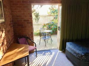 A seating area at Inverloch Central Motor Inn