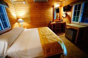 A bed or beds in a room at Lotus Resort
