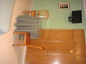 Una televisión o centro de entretenimiento en Hostal Serpol