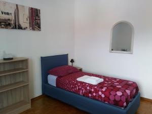 Ein Bett oder Betten in einem Zimmer der Unterkunft B&B Taramelli