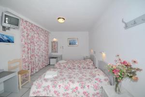 Un ou plusieurs lits dans un hébergement de l'établissement King Thiras Hotel