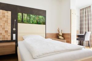 Postel nebo postele na pokoji v ubytování Vortuna Gesundheitsresort Bad Leonfelden