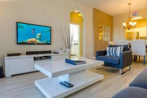 A television and/or entertainment centre at Incredible Condo - Just 2 Miles from Disney #201