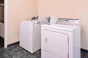 A kitchen or kitchenette at Red Carpet Inn