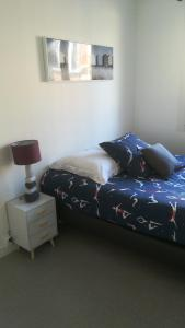 A bed or beds in a room at Le Perret