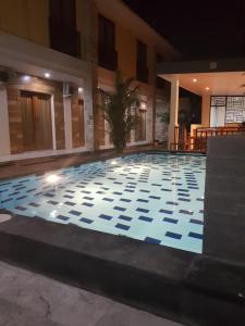 The swimming pool at or near Praba Guesthouse