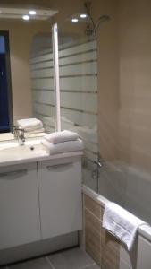 Salle de bains dans l'établissement Alpha
