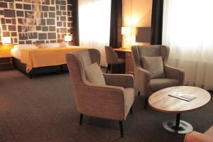 Ein Sitzbereich in der Unterkunft Hotel Hamburg-Wittenburg van der Valk