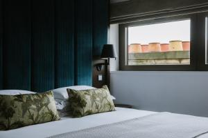 A bed or beds in a room at Cheval The Edinburgh Grand
