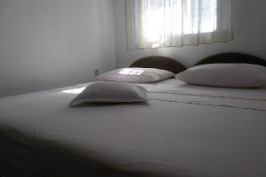 Postelja oz. postelje v sobi nastanitve Apartments Varos