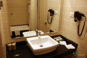 A bathroom at Park Village Resort by KGH Group