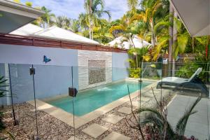 The swimming pool at or near Hanalei Beach House Port Douglas