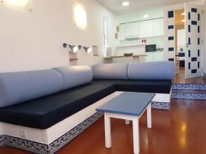 A seating area at Apartamentos Turisticos Soldoiro