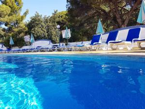 The swimming pool at or near Apartamentos Turisticos Soldoiro