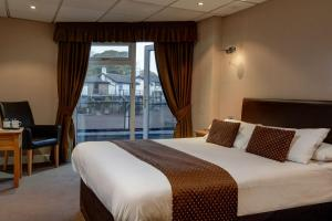 A bed or beds in a room at Best Western Preston Chorley West Park Hall Hotel and Leisure Club