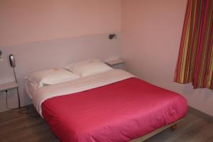 Un ou plusieurs lits dans un hébergement de l'établissement La Belle Étoile