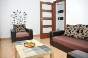 A seating area at Group Gamma Accommodation