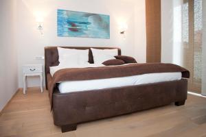 Ein Bett oder Betten in einem Zimmer der Unterkunft Residenz am See