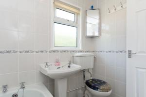 A bathroom at Sunbeach Holiday Homes